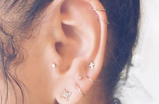 Bijoux Les piercings constellation disséminent des astres sur tes oreilles